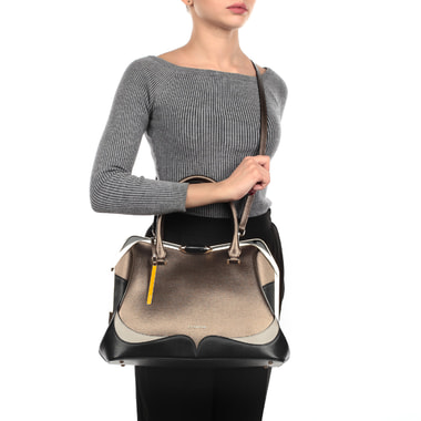 Вместительная кожаная сумка с рамочным замком Cromia